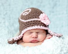 Ravelry: Squiggle'n'Swirl Beanie with Flair Earflaps pattern by RAKJpatterns