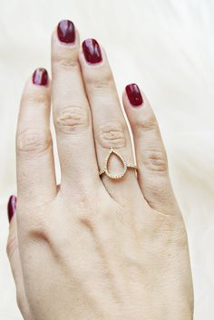 I love the minimalist design this ring has- with the addition of a little bling to go with.