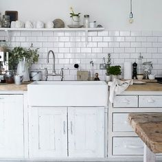 I love the sink, wooden counter tops and island. Just needs a window over the sink!