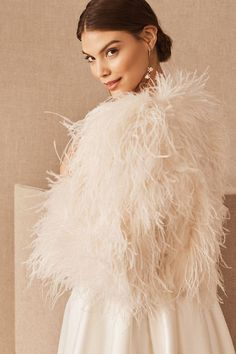 Equal parts glamorous and playful, we love this feathery jacket paired with a sleek slip dress or modern jumpsuit.