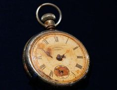 This pocket watch, that stopped at 01:50 ship's time, half an hour before Titanic sunk. The watch was recovered from the dead body of Steward Sidney Sedunary, and is on display at SeaCity Museum in Southampton.:
