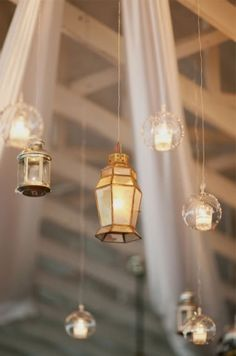 What if you did like hanging twinkling lights everywhere and then hanging lights/lanters over each table? Pretty hanging lanterns and tea candles—great idea for a barn wedding! {Photo by Jodi Millier via Project Wedding} Wedding Reception Lighting, Romantic Wedding Receptions, Rustic Wedding, Our Wedding, Wedding Ideas, Hanging Lanterns, Hanging Lights, Rustic Lanterns, Twinkle Lights