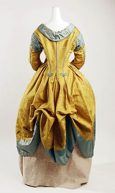 Robe a la Polonaise. After 1772,  the three portions of the skirt can be drawn up. Features a cutaway bodice styled like a man's frock coat, and worn over a gilet, or vest. There is no waist seam, and the bodice hangs loosely front the center front.  Polonaise gowns could have long or short skirts, and be worn over long or short kirts, and be worn over long or short petticoats that most commonly matched the gown fabric. American Duchess: The Many Types of Late 18th Century Gowns