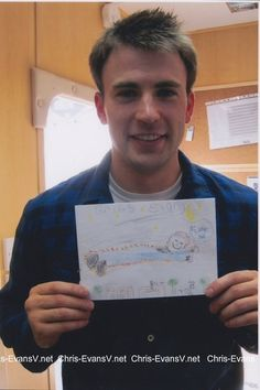 Ok that's so sweet, a little kid draws Chris Evans a picture.