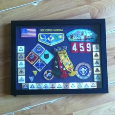 Cub Scout shadow box of memories, awards and achievements.