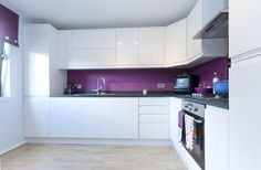 white kitchen with a hint of purple