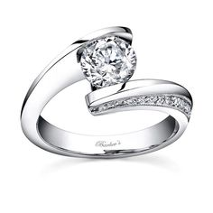 Bold contemporary styling make a strong statement of confidence for the person who wears this diamond engagement ring.  A take on the vintage bypass ring of yesterday, this modern version has taller walls and narrower ridges capturing the channel set round diamond center securely in it's grasp.  Pave set diamonds cascade down the side walls and a milgrain finish adorns the diamond ridges for a touch of  pizzazz  from every angle.<br />  <br />  Also available in 18k and Platinum.<br />