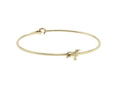 The solid gold Hummingbird bangle to remind the wearer to 'Beat Your Wings and Fly'.