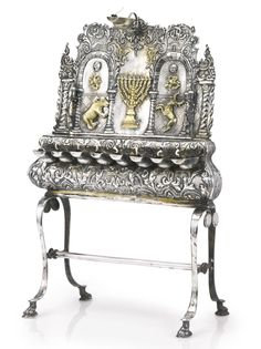 A German Silver Hanukah Lamp. Some1 says this represents the union of Dave Beckmann & I, & our families. Personally, I don't know. Dave please confirm.