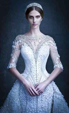 Michael Cinco F/W2014...Wow love the bling. Cheaper to have custom-made than purchasing from salon. Pick 1-3 details to recreate for that unique wedding dress. Be open for suggestions from your dressmaker.