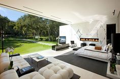 Glass Window across the entire back wall of the house. The Glass Pavilion, an ultramodern house in Santa Barbara, California by Steve Hermann