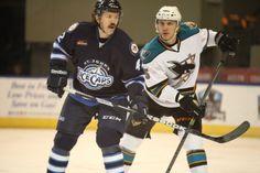 Worcester Sharks defenseman Matt Tennyson battles with St. John's IceCaps forward Josh Lunden (Feb. 22, 2014).