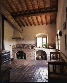 I like the overall look of (probably handmade) clay tiles, whitewashed walls and natural softwood ceiling/roof structure.