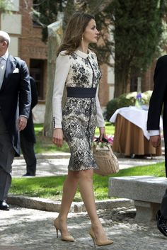 Crown Princess Letizia of Spain. I dont get where the bag comes in, something classy would have been more suiting