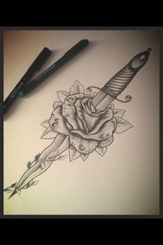 Rose and dagger tattoo.