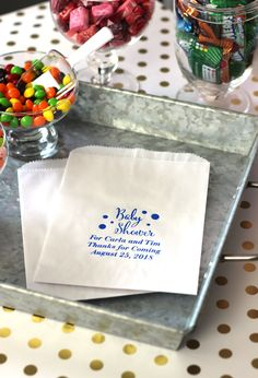 You can't go wrong with a bag full of candy for your baby shower souvenirs. Send guests home with candy from your candy buffet, a slice of cake, or other homemade treats in cute personalized favor bags.  These baby shower candy buffet bags are personalized with an adorable baby design and three lines of text to craft your own thank you message to friends and family. 4 bag colors. To order these favor bags visit http://www.tippytoad.com/personalized-baby-shower-candy-favor-bags.asp