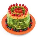 Ingredients:  Large seedless watermelon  Other fresh fruit, such as melon balls, kiwi slices, and berries  Instructions:  1- Start by slicing the watermelon into wedges and then arrange them in a stack of circles (rinds facing out) to create a cake shape, as shown. Decorate the cake with the other fruits.