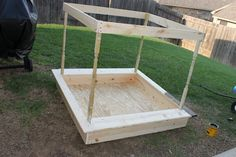 DIY sandbox (pottery barn copycat), love this idea!! has a little canopy for shelter!!