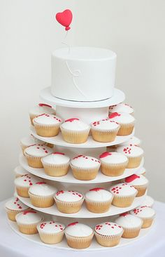 I am somewhat obsessed with cupcakes. I love baking cupcakes and, yes, I love eating them. Fondant Cupcakes, Wedding Cakes With Cupcakes, Cupcake Cakes, Cupcake Wedding, Heart Cupcakes, Simple Cupcakes, Yummy Cupcakes, Pretty Cakes, Cute Cakes