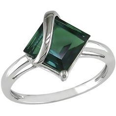 I like the simplicity and uniqueness of this emerald ring