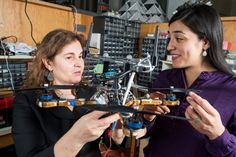 Security for multirobot systems Researchers including MIT professor Daniela Rus (left) and research scientist Stephanie Gil (right) have developed a technique for preventing malicious hackers from commandeering robot teams communication networks. To verify the theoretical predictions the researchers implemented their system using a battery of distributed Wi-Fi transmitters and an autonomous helicopter. Image: M. Scott Brauer. Distributed planning communication and control algorithms for…
