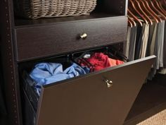 Incorporating laundry storage in your closet lets you keep dirty clothes out of sight yet readily accessible. Add a removable liner so you can easily transport the clothes to the laundry room. Photo courtesy of California Closets