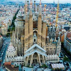 Spain - La Sagrada Familia is a giant basilica in Barcelona that has been under construction since 1882 and was designed by the architect Antoni Gaudi.