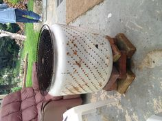 Use an old washing machine drum for a well ventilated fire pit!