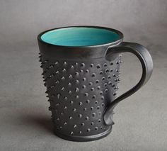 Get a bit pointy with this awesome spiky mug. So when those dreaded unwanted hands reach for your precious coffee. Bam That's what you get
