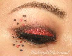 Brows: NARS Bali shadow  Eyes: e.l.f. Eyelid Primer, NYX Jumbo Pencil in Milk, Fyrinnae Pixie Epoxy, Illamasqua Daemon shadow, Rock & Republic Fatalistic, red cosmetic glitter, false lashes, La Femme Eyeliner Sealer