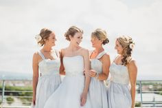 Bride and bridesmaids - wearing soft grey gowns with peonies in their hair  photo by tobiah tayo photography - available for commissions worldwide www.tobiahtayo.com