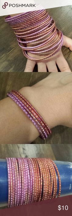 24 Bangle Bracelets These have barely been warn. It has different shades of pink. Jewelry Bracelets