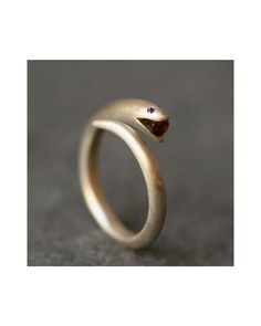 {Snake Ring} w/ ruby eyes + garnet in its mouth.