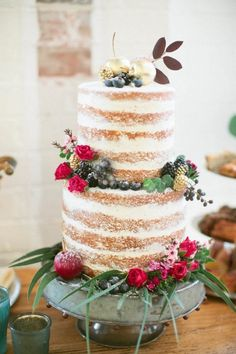 Naked cake powdered sugar red roses berries gold accents | Wedding cake ideas and inspiration | rustic Summer themed wedding via @junebugweddings
