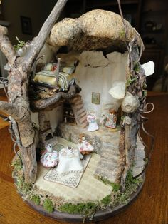 All kinds of inhabitants ! Tree stump house for mice...   This is so cute.