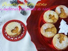 Biscotti natalizi con frolla all'olio e marmellata