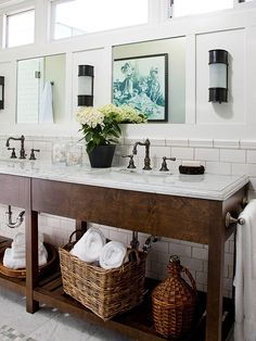 To provide contrast to the whimsical floor and shower tiles, the homeowners incorporated traditional elements that convey a vintage nautical vibe, such as the espresso-finish wood vanity. Other nautical details include the thick white molding that frames the mirrors and clerestory windows above the vanity./