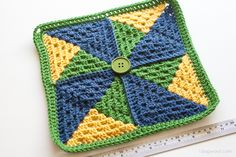 Three colors of yarn and a few simple stitches make up this geometric pinwheel afghan square. Free pattern included.