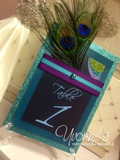 Hey, I found this really awesome Etsy listing at https://www.etsy.com/listing/215001327/peacock-table-numbers-with-glitter