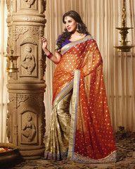 Orange and golden colour half brasso and half Georgette material designer saree