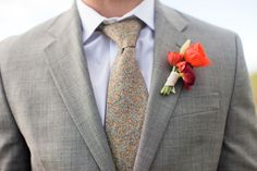 Poppy and ranunculus boutonniere. Image by Ashley Biess Photography / http://www.ashleybiess.com