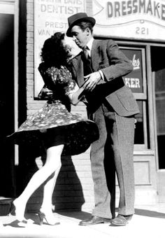 """""""Jewel McGowan, national jitterbug champion, shows James Stewart how to cut rug in """"Pot o' Gold"""" (1941).  She says Jimmy cuts neat pattern although her toes may think differently."""""""