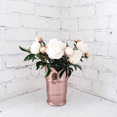Peonies in a rose gold vase