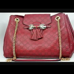 Authentic Beautiful Emily Gucci Bag! Authentic Burgandy Emily Gucci Bag has light gold chain straps, in new condition, has original dust bag.... Gucci Bags Shoulder Bags