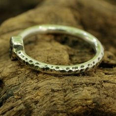 Sterling silver hand textured ring with genuine rough diamond with silver bezel setting