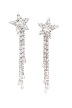 The 1932 Collection  Etoile Filante earrings in 18K white gold set with two round-cut diamonds, 32 fancy-cut diamonds, 104 baguette-cut diamonds, 46 princess-cut diamonds, and 10 brilliant-cut diamonds.