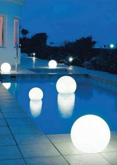 These floating light globes are a unconventional and stylish way to decorate your backyard.