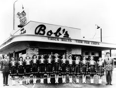 (1940)^* - Bob's Big Boy Restaurant opened in Burbank 1940 located at 624 S. San Fernando Boulevard. From left to right: Arnold Peterson, car hops, and Bob Wian.     restaurant chain was founded by Bob Wian in Southern California in 1936, originally named Bob's Pantry. best known for  trademark chubby boy in red-and-white checkered overalls holding a Big Boy sandwich (double-decker cheeseburger). The inspiration forname model  was Richard Woodruff (1936–1986), of Glendale, Ca six years old,