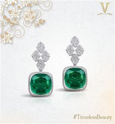 These stunning diamond and emerald earrings shine and sparkle with pride.