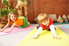 Yoga for kids! Excellent exercise! And stretching is healthy for the body!    Aline